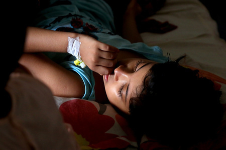 A kid with a Cannula at the hospital in Dhaka. A number of children spent the Eid day undergoing treatment for dengue fever at different hospitals in Dhaka.