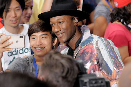 Singer-Songwriter Aloe Blacc takes a selfie with fan after his performance at Rockefeller Center in New York City.