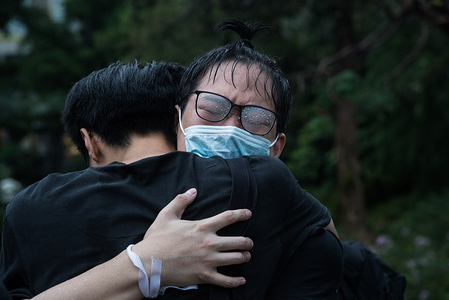 A protester cries as another protester embraces him during the demonstration. Thousands of Hong Kong educators came together in support of their students and emphasised the need to protect Hong Kong's youth. Many Hong Kong students have been active participants in the often violent anti-extradition protests that have taken place over the past few months.