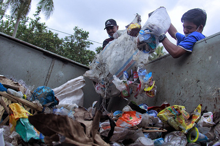 "Students dump rubbish into a garbage truck during the Anniversary. Students of the Environmental Care Movement (GPL) cleanup rubbish on the Coastal Tourism Area of Lhok Bubon, Samatiga, Aceh Barat in commemoration of the 74th Anniversary of the Indonesian Independence Day with a topic ""Let's Free the Marine Biota by Not Throwing Trash into the Sea""."