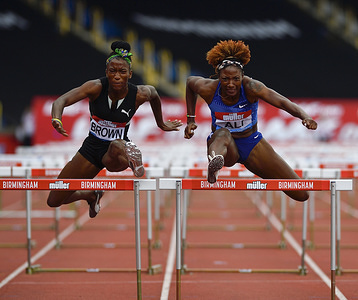Janeek Brown (Jamaica) and Nia Ali (USA) in action during the IAAF Diamond League Athletics at the Alexander Stadium in Birmingham.