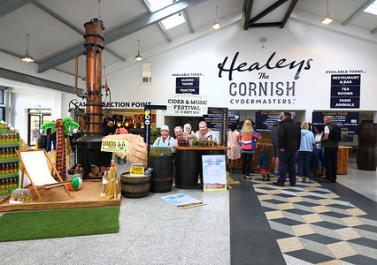 Entrance lobby at the Cyder farm in Penhallow. Healey's Cornish Cyder Farm is an independent family run business in Penhallow, UK. It brews and sells its own cyder, brandy, whisky, country fruit wines and apple juice, all produced on site. Its main cyder brand is Rattler which is available in both cloudy and pear varieties.