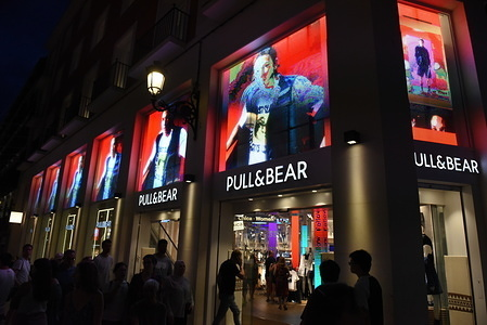 People walk past a Pull&Bear store on Preciados Street in Madrid.