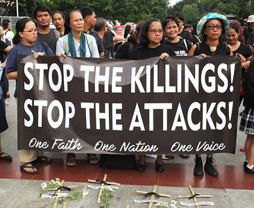 Protesters hold a banner with a slogan, Stop the Killings, Stop the Attacks during the demonstration. Families of slain victims of alleged summary killings at Negros province staged a Protest rally at Liwasang Bonifacio in Manila during The National Day of Mourning & Solidarity to call for an end to the killings in the region.