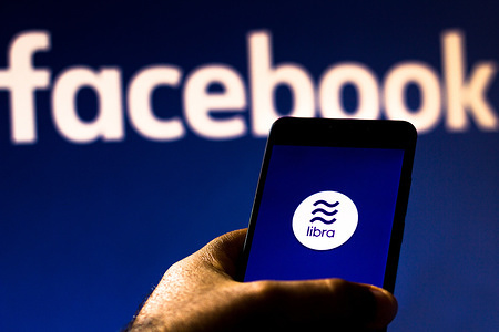 In this photo illustration the Facebook Libra logo is seen displayed on a smartphone.
