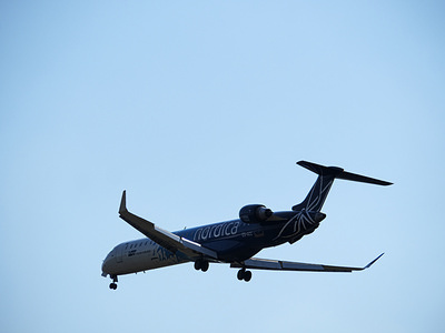 A LOT Polish Airlines Bombardier CRJ-900ER in the blue sky.