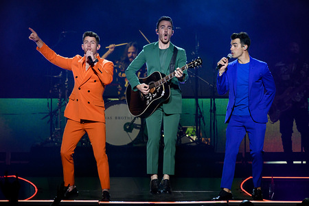 Kevin Jonas, Joe Jonas and Nick Jonas members of the American pop rock band, Jonas Brothers, perform at a sold out show in Toronto.