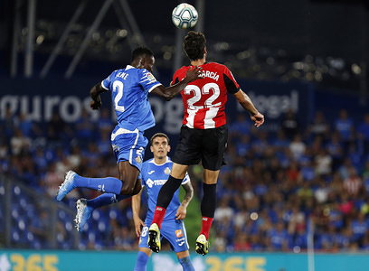 Athletic Club de Bilbao's Raul Garcia and Getafe CF's Djene Dakonam in action during the Spanish La Liga match between Getafe CF and Athletic Club de Bilbao at Coliseum Alfonso Perez, Getafe. (Final score: Getafe CF 1:1 Athletic Club de Bilbao)