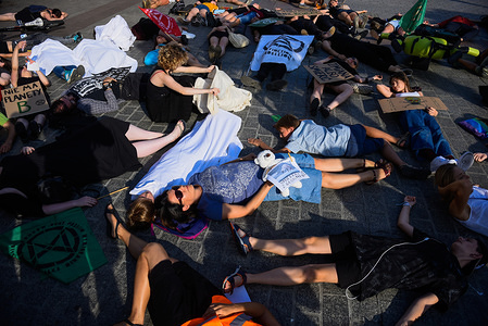 Protesters lay on the ground pretending to be dead (Die in action) performance at the Extinction Rebellion branch, Main Square during the demonstration. The symbolic activist action highlights the problem of mass extinction and show the dangers of human activities connected with the climate crisis or climate change, a current worldwide situation.