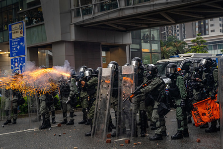 Riot police fire a tear gas canister towards the protesters during the demonstration. Tens of thousands of Pro-democracy protesters rallied on the streets of Hong Kong in another round of demonstration triggered by the now suspended extradition bill put forward by the government. However demonstrators are calling for a total withdrawal of the bill and demand the government to set up a independent body to investigate on the police brutality actions against protesters.