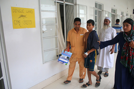A Hospital ward boy helps a new dengue patient to move at the Dengue ward at Holy Family Medical College and Hospital in Dhaka. Bangladesh records nearly 60,000 patients hospitalised for dengue so far in 2019. According to the Directorate General of Health Services or DGHS, a total of 59,592 dengue patients have been admitted to the different hospitals across Bangladesh from the beginning of the year.