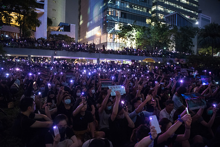 Protesters raise purple lights during the demonstration. Thousands of anti-government protesters attended the metoo rally, where various leaders spoke out against the acts of sexual violence committed by the Hong Kong police during anti-extradition protests. Protesters shined purple-colored lights in support of the metoo movement while holding up various placards criticizing the police.