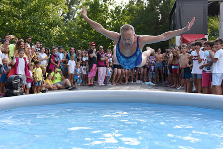 A reveller jumps into a swimming pool during the La Bajada de Jesús festival in Almazán north of Spain, where high temperatures reached 34º degrees Celsius at the afternoon hours. Spanish's weather agency AEMET said that five provinces are with a orange o yellow alert for tomorrow,  Friday, August 30, with temperatures reaching up to 38 Celsius degrees during the day.