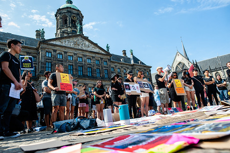 A group of people from Hong Kong with placards, listen to speeches, during the demonstration. People gathered wearing black clothes at the Dam Square protesting in solidarity with Hong Kong people. Protests have been happening for two months, over a now-suspended extradition bill but demands have expanded to calls for democracy and political reforms. The Hong Kong government has not responded to any of the 5 demands of the Hong Kong people.