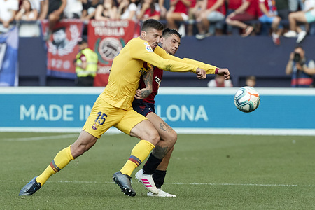 Clement Lenglet (defender; FC Barcelona) and Chimy Avila (forward; CA Osasuna) in action during the Spanish La Liga Santander, match between CA Osasuna and FC Barcelona at the Sadar stadium. (Final score: CA Osasuna 2 - 2 FC Barcelona)