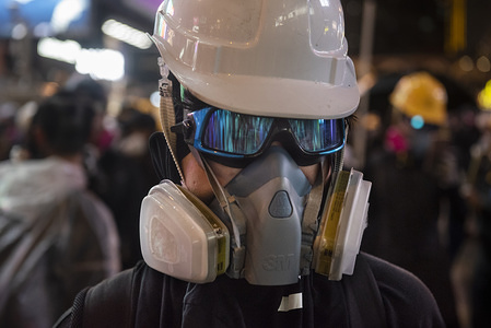 A protester with a gas mask and an helmet during the demonstrations. Anti-government demonstrations continue one more weekend in Hong Kong, these began in June 2019 over a now-suspended extradition bill to China.