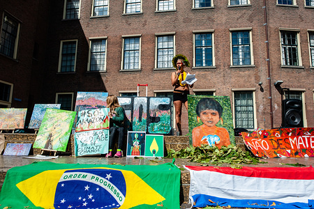 Sandra Batista, Brazilian artist and activist speaks during the protest. Brazilians living in The Netherlands organised a demonstration in solidarity with rain forest protectors and against the president of Brazil, Jair Bolsonaro. Around fifty people gathered at The Hague to show their support.
