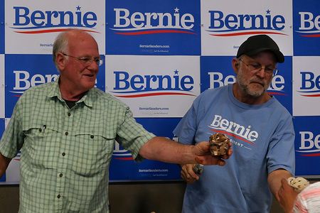 Famous ice cream makers Ben Cohen and Jerry Greenfield serve ice cream at a Bernie Sanders' ice cream social in Raymond, New Hampshire.