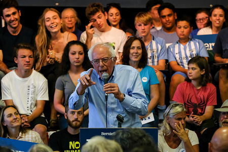Democratic presidential candidate, Bernie Sanders discusses health care costs at an ice cream social in Raymond, New Hampshire hosted by Ben Cohen and Jerry Greenfield, the founders of Ben and Jerry's Ice Cream.