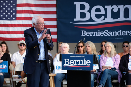 Democratic presidential candidate, Bernie Sanders discusses health care costs at an ice cream social in Dover, New Hampshire hosted by Ben Cohen and Jerry Greenfield, the founders of Ben and Jerry's Ice Cream.