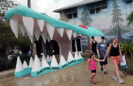 People leave Gatorland following a rain shower as Hurricane Dorian approaches.  The Category 5 storm is expected to come dangerously close to the Florida coast as early as tomorrow night.