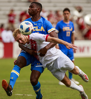 Indiana University soccer player A.J. Palazzolo (4) and UCLA's Jefferson Alade (11) are seen in action during a football match between Indiana University and University of California Los Angeles at Armstrong Stadium in Bloomington. (Final score: Indiana University 2 - 1 UCLA).