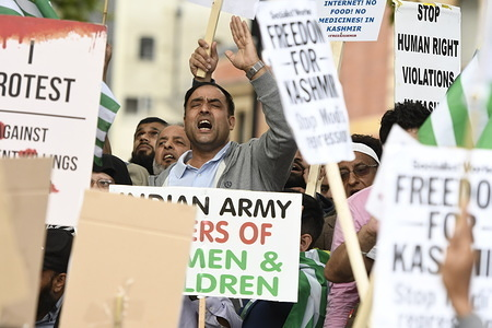 A protester chants slogans during the demonstration. Kashmir protesters gathered at Parliament Square to demand the stop of the Indian occupation in their territory and the human rights violations. They ask the Indian government to begin the process of demilitarisation and restore democracy in their territory.