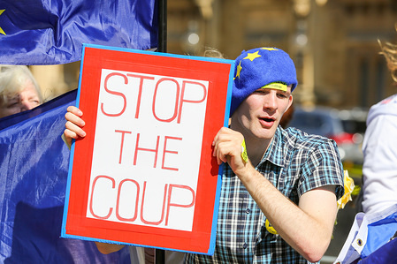 Anti-Brexit protester holds a placard during the demonstration. Pro and Anti-Brexit protesters gathered at the Parliament Square, hours after the Queen approved the Prime Minister's prorogation request.