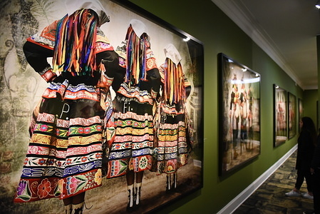 "A picture of villagers dressed in traditional costumes at the Mate museum during the exhibition in Lima. Mario Testino exhibition ""Alta Moda"" is the result of a five-year project that investigates both Peruvian traditions and the history of photography at the Mate museum in Lima."