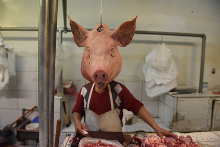 A pig's head on display at a butchers in the Central market in Lima