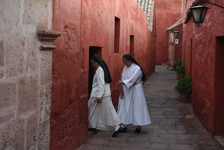 Nuns walk inside the monastery of Santa Catalina in Arequipa. The Santa Catalina Monastery UNESCO World Heritage, which was founded in 1580 by doña María de Guzmán, is one of the most important religious buildings around the world. It has served as a cloister for Dominican nuns from the sixteenth to the eighteenth centuries, and still houses a small religious community today.