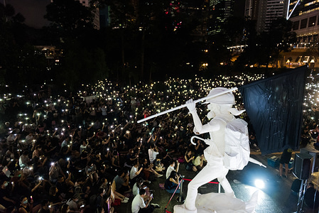 """Protesters light up their phones in support of the anti-extradition movement  during the demonstration. Thousands of anti-government protesters held a rally condemning the """"white terror"""" in the latest demonstration of the anti-extradition movement. The rally remained peaceful with various figures giving speeches and protesters simultaneously lifting their phones in support of the movement."""