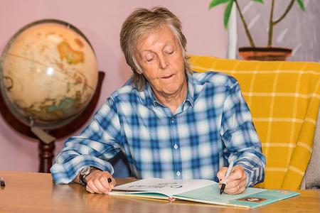 Sir Paul McCartney meets school pupils at the launch of his new children's book 'Hey Grandude' in London.