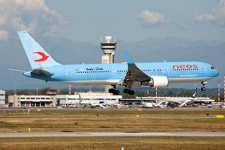 A Neos Boeing 767-300ER carrying italian holidaymakers back to Milan Malpensa airport.