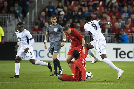 Aricheell Hernandez (10), Maykel Reyes (9), Samuel Piette (6) and Doneil Henry (15) are seen in action during the Nations League qualifier game between Canada and Cuba at BMO Field in Toronto. (Final score; Canada 6:0 Cuba)
