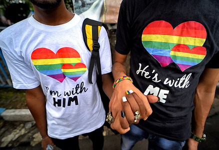 Young Gay couple of LGBT Community hold their hands before attending the Queer march. The historic verdict on partial decriminalization of Section 377 which came on 6th September, 2018 to start sensitization programs for all LGBT Community, but after this last 1 year there is no development from the Government's side hence the protest march again organised by the West Bengal Forum for Gender and Sexual Minority Rights.