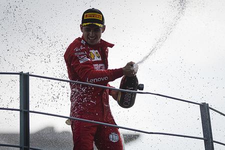 Scuderia Ferrari's Monegasque driver Charles Leclerc celebrates after winning the Italian F1 Grand Prix race at the Autodromo Nazionale di Monza.