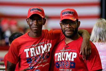 Supporters in Trump t-shirts await President Trump during the MAGA rally in Fayetteville.