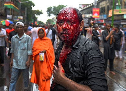 (EDITOR'S NOTE: Image contains graphic content.) A Shia Muslim devotee after dangerously wounding himself with Swords while showing his grief during the Muharram procession of Kolkata. Muharram is the first month of the Islamic calendar & Ashura is the tenth day of the month of Muharram on which the commemoration of the martyrdom of Imam Hussain, the grandson of Prophet Muhammad (PBUH), during the battle of Karbala, is done. It is part of Mourning for Shia Muslims and a day of fasting for Sunni Muslims that is observed all over the World.