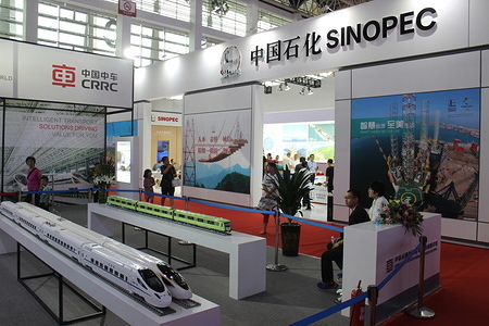 A Model of a high speed train with SINOPEC logo seen on the background at Ningxia International Hall. The China-Arab States Expo is a biennial event with ambition to promote commercial cooperation between China and Arabic countries. This year's edition attracted 12600 guests and over 2900 regional organizations and chambers of commerce according to the official data.  This 4th edition is focused on high technology and provided an opportunity to test the products of major Chinese brands, and to check their popularity among the local visitors. The expo was hosted in Yinchuan, the capital of Ningxia autonomous region, which aims to become a bridge between China, Central Asia and Middle East.