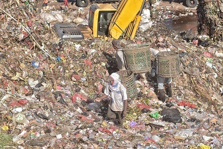 Scavengers sort and collect plastics for recycling at the garbage mountain in Bantar Gebang landfill that is considered to be the world's largest dump.  Jakarta's Bantar Gebang Integrated Waste Treatment Area (TPST Bantar Gebang) was established in 1985. On average, 7,000 tons of waste are dumped annually at the landfill, which is expected to exceed its limit in 2021.