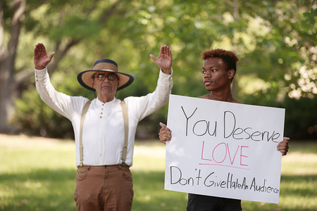 """George Edward Smock, aka Brother Jed, left, preaches. Later he was led away to a police car after preaching about religion, criticizing students, and talking about politics to a group of students Wednesday, September 11, 2019 at Indiana University in Bloomington, Ind. Smock's wife, Cynthia D. """"Cindy"""" Lasseter, was also taken to a separate police car. The couple were cited for trespassing, and asked to leave. The preachers had been preaching to students near Woodburn Hall for several hours, and spoke to students in descriptive terms about sexuality, religion, and other subjects. As Smock began using phrases such as, """"build the wall,"""" and expressing his support for United States President Donald J. Trump, a group of students began to surround him, and the mood of the group surround him changed from amusement and mockery, to a more threatening tone of derision and disgust, and that's when members of the IU police department moved in to peacefully defuse the disturbance. Earlier in the day police had been called to the scene after a confrontation involving at least one person, and the preachers, and police discussed in scanner traffic detaining the couple, and moving them to another location to talk to them. A group of at least 100 students had been surrounding the couple, and at least four had moved into a zone of a few feet from Smock. For a while police stayed back, and let the couple preach. The couple are widely known on campus for preaching to students, and had been on campus several times in the past few days."""