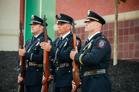 Members of the Indiana University police hold rifles after a 21 gun salute during the 9/11 remembrance event hosted by Ivy Tech Community College's Bloomington campus, in coordination with the City of Bloomington and Bloomington Metropolitan Fire Fighters Union Local 586. Bloomington mayor John Hamilton, Fire Fighters Union Local 586 Member and Honor Guard Coordinator Robert Loviscek, Retired Indiana State Fire Marshal Jim Greeson, and Bloomington Fire Department Chaplain, Harold Godsey spoke during the event. A beam from the World Trade Center is part of a memorial at Ivy Tech. Eighteen years ago 2,977 people, including 343 firefighters, and 71 law enforcement members, were killed during a terrorist attack on September 11, 2001.