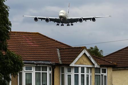 An A380 Etihad Airline plane approaching London Heathrow Terminal 3 airport.