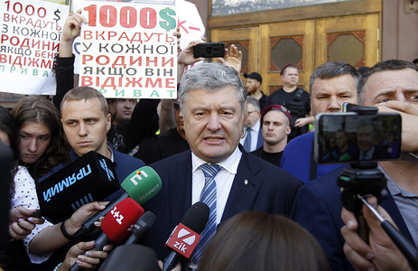 """Former Ukrainian President Petro Poroshenko seen speaking to journalists, after his questioning at the State Investigations Bureau in Kiev, Ukraine.  The fifth President of Ukraine, Petro Poroshenko testified in the case of the nationalization of a Private Bank and capture of Ukrainian sailors in the Kerch Strait, as local media agency (UNIAN) reported. Law enforcers are searching the premises of """"International Investment Bank"""", whose main owner is former Ukrainian President Petro Poroshenko."""
