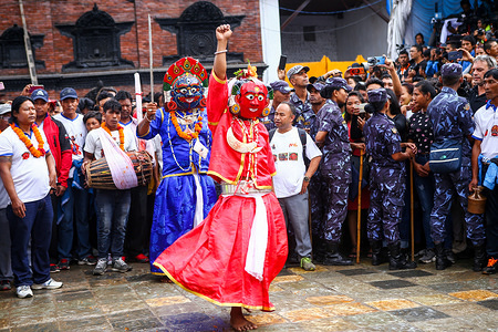 Masked dancers perform during the main day of the Indra Jatra festival. People across the country attended the eight-day long festival which is celebrated to honour Indra, the king of gods and god of rains. During the festival the living goddess is taken around the city in the chariot in a religious procession through parts of the capital by Nepalese Hindus and Buddhists. The festival also marks the end of the monsoon.
