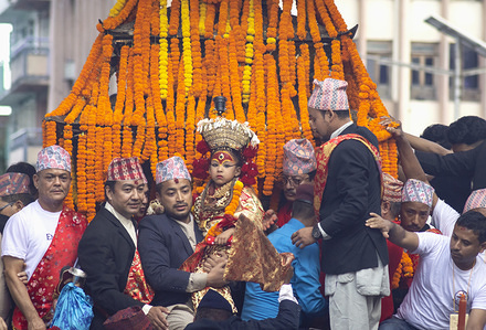 Devotees pull the chariot of goddess Kumar during the festival. People celebrate Indra jatra to honour Indra, king of heaven and lord of rain, on the main day the chariot of god Kumari, Ganesh and Bhairav is pulled around the places of basantapur.