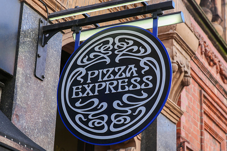 An exterior view of the Pizza Express.  Pizza Express is a Chinese-owned restaurant group with over 470 restaurants across the United Kingdom and 100 overseas in Europe, Hong Kong, China, India, Indonesia, The Philippines, Singapore and the Middle East. It was founded in 1965 by Peter Boizot.