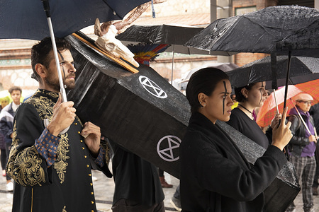 Participants carry a coffin which symbolises the animal extinction during the event. Extinction Rebellion event organized by international movement (created in 2018) to share a vision of change in the society to prevent the effects of climate change took place Last Saturday at Matadero Cultural Centre in Madrid.