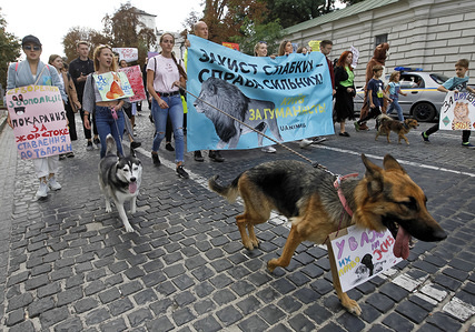 Participants with their pets during the march. 'All-Ukrainian March For Animals Rights' with a demand to prohibit the using of animals in circuses, ban of fur farms and creation of zoo police. The march simultaneously took place in 24 cities of the country aiming at popularising humanistic values and protect animals from cruelty.